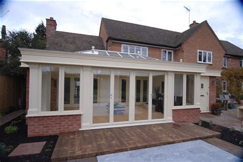 Home Kitchen Designs pullee hardwood orangery in cream painted finish with