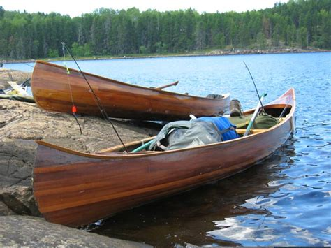 Handmade Canoes - handmade wood canoes and paddles