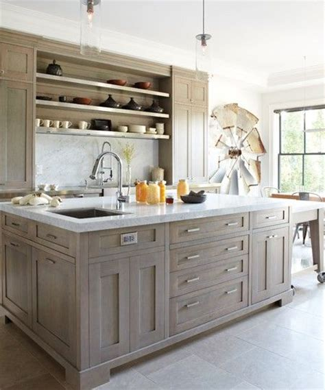 light grey stained wood or grey cabinets like