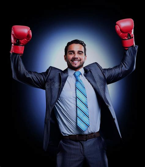 Boxing Equipment Win Max businessman in a suit and boxing gloves celebrating a win