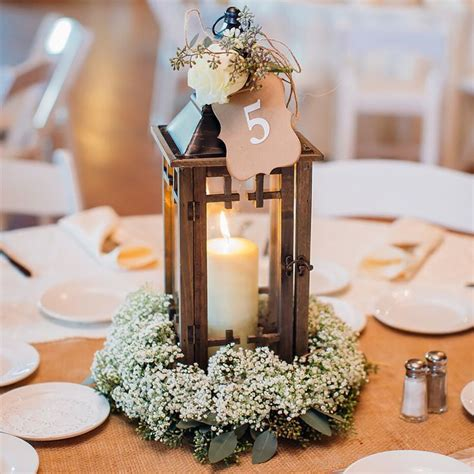 lantern centerpieces for wedding tables lantern centerpiece with babies breath by designs