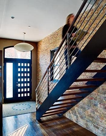 stairs, brick wall reusing bricks from existing house
