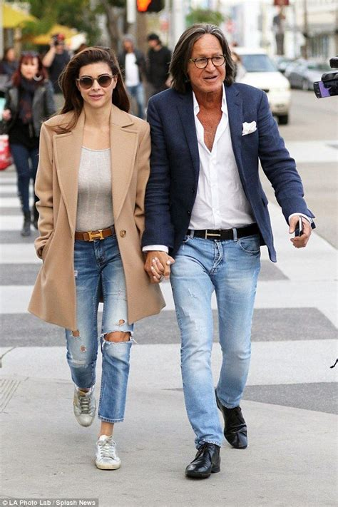 how old is mohamid from the beverly hills house wives mohamed hadid and fiance shiva safai hold hands hold