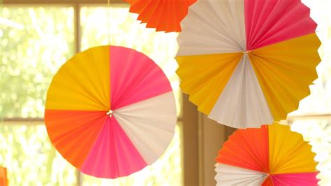 How To Make Hanging Paper Fans - how to make hanging paper fan medallions kin diy