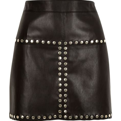 river island black leather look studded mini skirt in