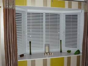 Bow Window Shades white venetian blinds covering bay windows revealed behind
