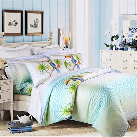 tropical themed bedding turquoise green and off white animal parrot bird and wave