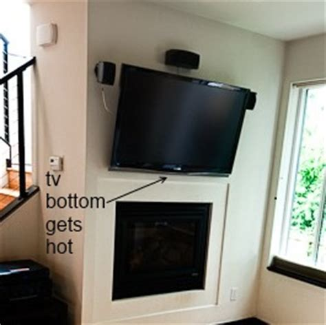 tv fireplace heat shield how to prevent wall mounted tv above fireplace from