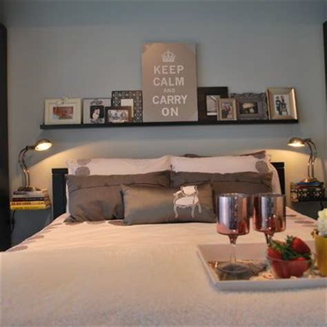 over the bed shelf love the floating books instead of bedside tables shelf