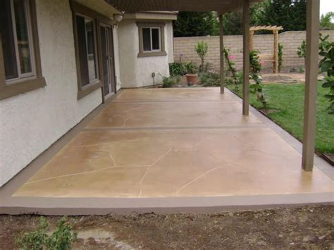 concrete patio saw cut stone patterns and stained in
