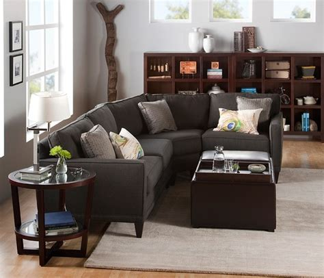 light gray wall white trim dark light woods charcoal couch etc books worth reading