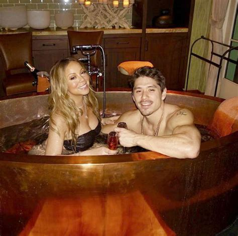 mariah carey in bathtub mariah carey flaunts extreme cleavage in studded bra in