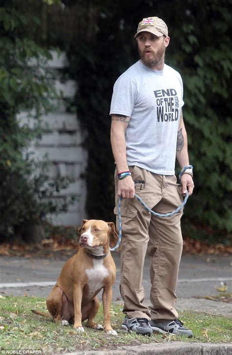 tom s dogs bearded tom hardy takes his cass for a walk in