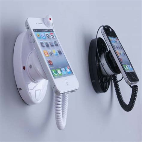 Mobile Phone Rack by Anti Theft Cell Phone Security Alarm Stand Holder From