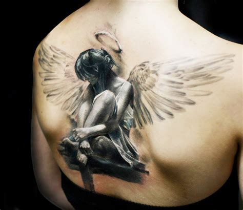 tattoo angel woman big wings sad angel girl tattoo on upper back
