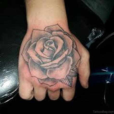 rose on hand tattoo meaning 61 looking flowers on