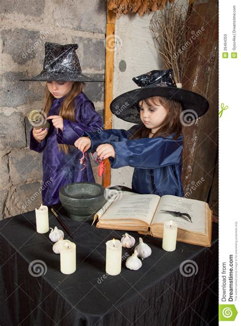 two little witches a 0763633097 two little witches stock photo image 26464350