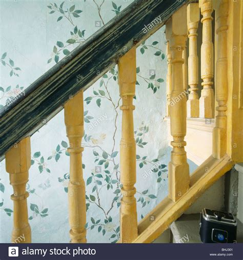 painted banisters pictures close up of yellow painted banisters on staircase with stenciled wall stock photo