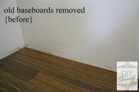 family room baseboard diy installation and caulking