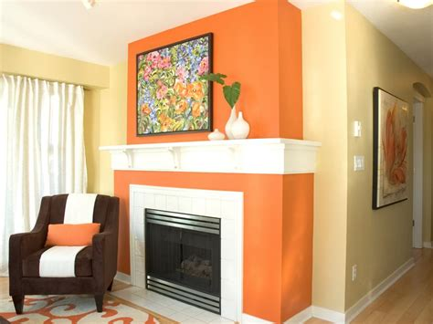 orange accent wall living room 15 fireplace remodel ideas for any budget hgtv