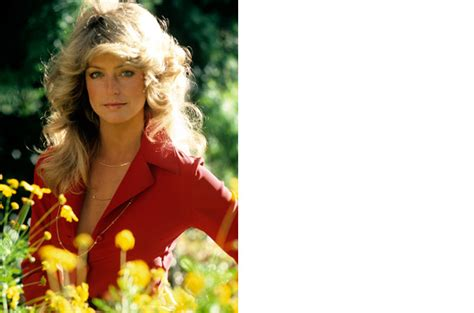 hairstylist giving a customer the 1970 s feathered look farrah fawcett all time top 100 icons in fashion style
