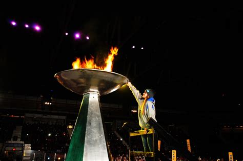 Lighting Olympic Torch by Celebrate Winter Sports And Olympics Lake Placid