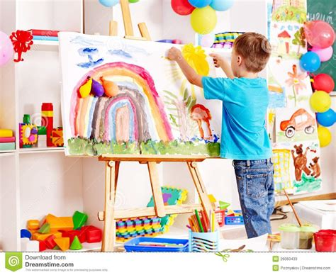 children s painting child painting at easel stock photos image 26060433