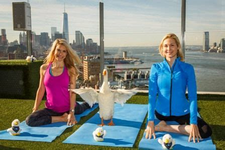 aflac commercial actress gym aflac s duck does yoga caign with kelly rutherford