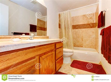 bathroom floor towels warm colors bathroom with red towels and rug royalty free