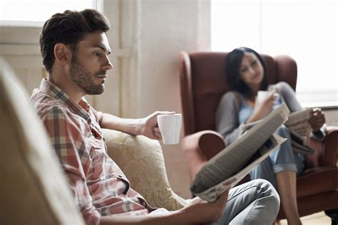 couples having on the couch 5 very real questions to ask before moving in together