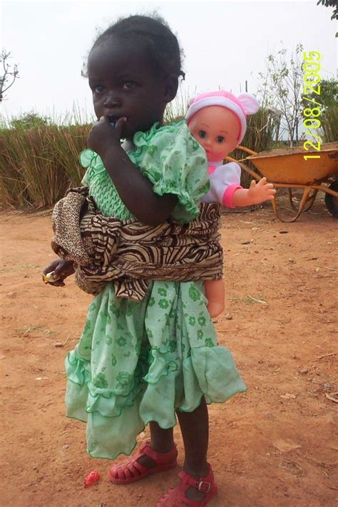 black doll play school child with doll see black child white doll