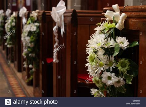 Church Wedding Flower Arrangements by Church Pews With Wedding Floral Arrangements Of Flowers In