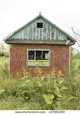 house with no windows old abandoned barn field stock photo 488633608 shutterstock