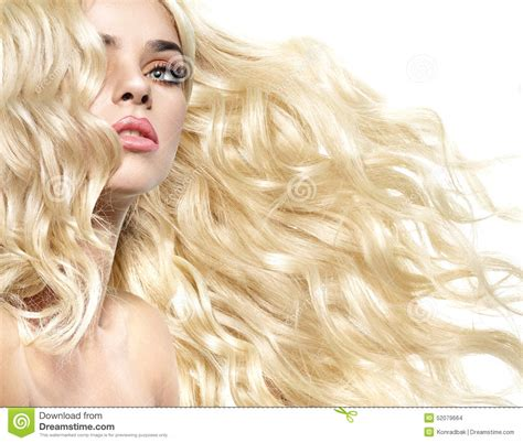 what is a bushy bushy blonde haircut portrait of the lady with curly and bushy hairstyle stock