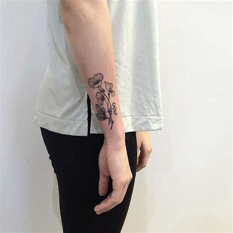 adele tattoo on left wrist for her parents thanks adele x jujutattoo flowertattoo