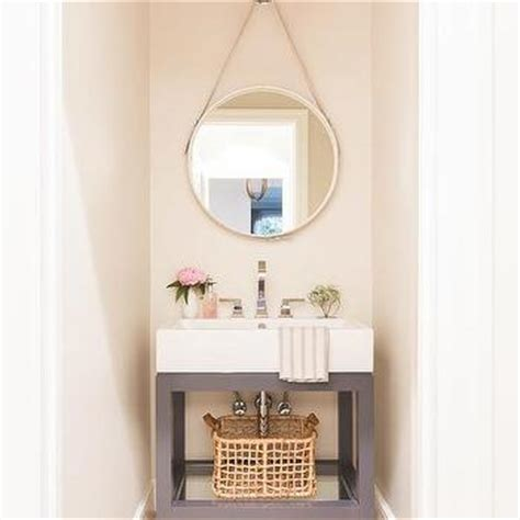 marvelous Very Small Powder Room Ideas #2: m_small-powder-room-white-hanging-mirror-beige-arabesque-floor-tiles.jpg