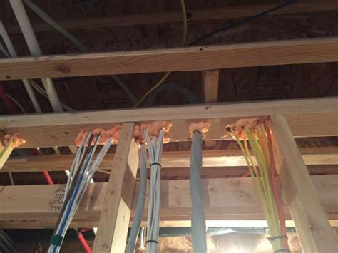 romex pulled tight through joist subfloor