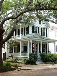 Charleston Style Homes by White Charleston House W Black Shutters Amp Green Tin Roof