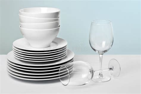 commercial barware commercial white dishes and crystal wine glasses stock