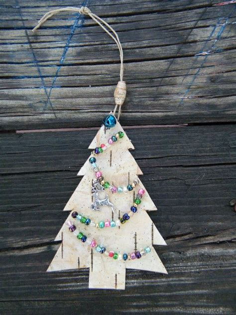 christmas tree made out of ornaments tree ornament made out of birch bark with a jingle bell reindeer charm and a birch