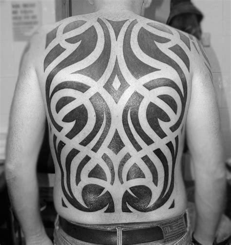negative space tribal tattoos 60 tribal back tattoos for bold masculine designs