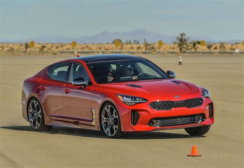 car and driver kia stinger 2018 kia stinger drive review an upscale sporty