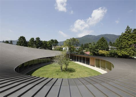 Glass Roof House japanese home betrays square exterior with teardrop shaped