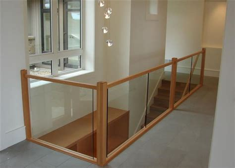 Wood And Glass Banister by The 25 Best Ideas About Glass Railing On