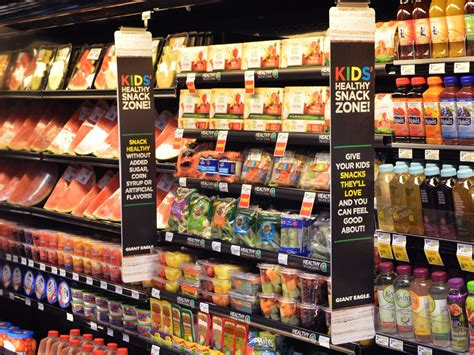 food section grocers lead kids to produce aisle with junk food style