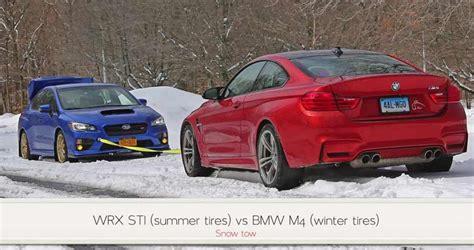 bmw vs subaru bmw m4 vs subaru wrx sti snow tow challenge