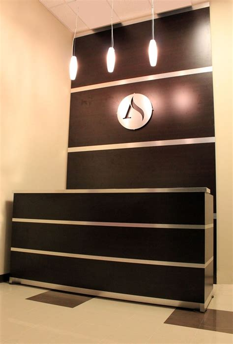 custom reception desk accent wall brushed aluminum