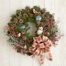 Nature inspired christmas wreath with owl berries branches and