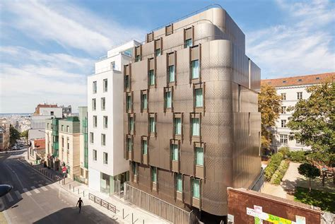 student housing rehabilitated parisian block includes daylit metal clad student housing student