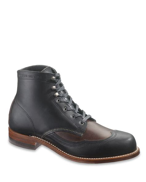 wolverine wingtip boots in brown for black